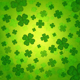 striped four-leaved shamrocks in green old paper background
