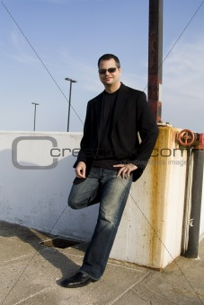Casual Male Leaning Against Wall