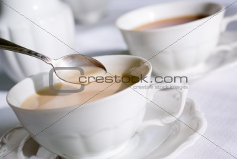 Teaspoon over cup of tea or coffee