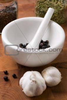 Juniper in mortar and pestle with garlic