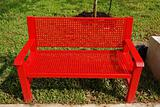 red color bench inside the horticulture parks