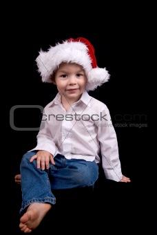 Boy in Christmas hat hat