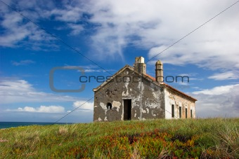 Abandoned house close to the sea