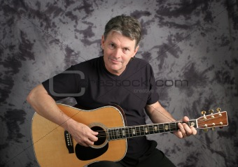 Stock Photo of a Mature Male Guitarist 1