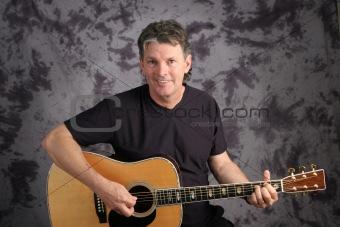Stock Photo of Mature Guitarist 3