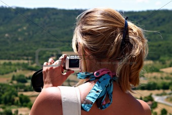 Blonde woman with digital camera