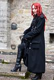Redhead flirty goth girl in a black coat