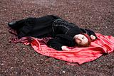 Redhead girl in with red satin cloak