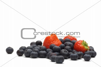 strawberry and bilberry on white background