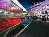 Speed blur of London bus in piccadilly circus at night 