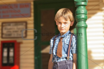 boy in front of shop