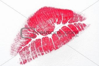 Lipstick kiss on writing paper