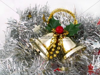 Christmas bells on silver tinsel background