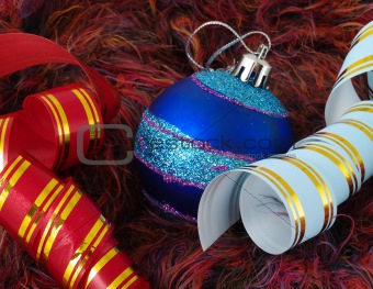 Christmas blue ball and ribbons on fluffy background