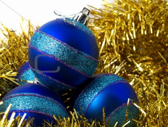 Christmas blue ornaments and gold tinsel