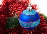 Christmas blue ornaments and red tinsel
