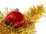 Christmas red ornaments and gold tinsel