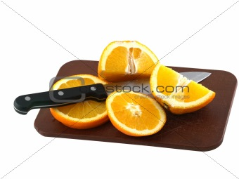Sliced of an oranges and knife