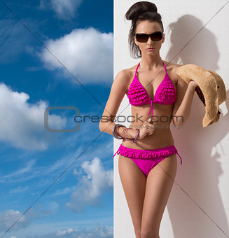 pretty brunette with bikini in front of the camera