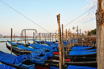 View to the gondolas and boats berth  in Venice.