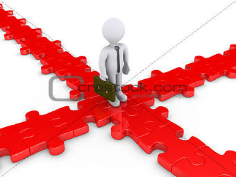 Businessman on puzzle pieces wondering for the right path