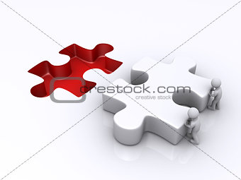 Two persons are pushing last puzzle piece