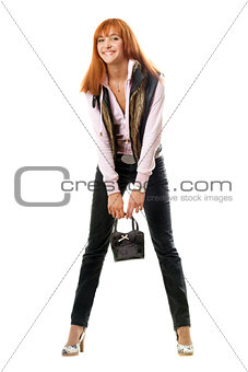 Joyful red-haired young woman with handbag