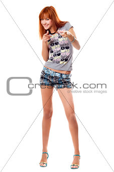 Cheerful red-haired girl in a t-shirt