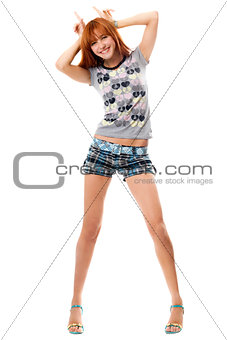Playful red-haired girl shows horns