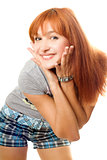 Close-up portrait of happy red-haired girl