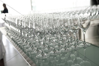 a lot of glasses on the bar