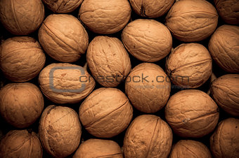 group of walnuts as background