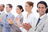 Close-up of a business team smiling and applauding 