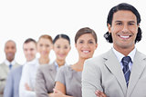 Big close-up of a happy business team in a single line looking s
