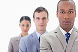 Big close-up of a business team in a single line looking straigh