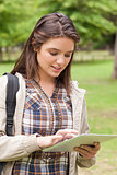 Close-up of a first-year student using a touch pad