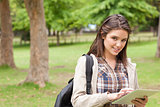 Portrait of a first-year female student using a touch pad
