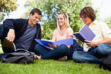 Low angle-shot of three students in a park
