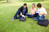 High angle-shot of three students in a park
