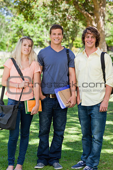 Three students posing side by side
