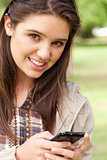 Portrait of a cute teenager using a smartphone