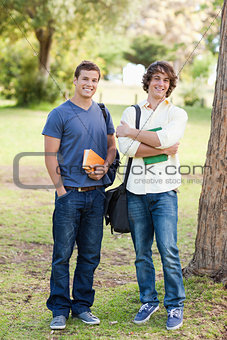 Portrait of two happy standing male students