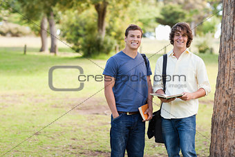 Portrait of two standing male students talking