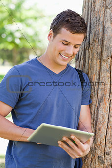 Close-up of a young man using a touch pad