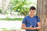 Muscled student using a smartphone