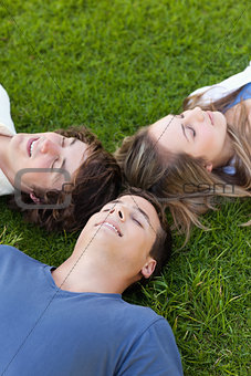 Three students lying together