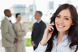 Young smiling businesswoman on the phone and tilting her head to