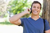 Close-up of a muscled young man on the phone