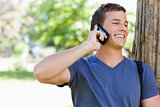 Close-up of a muscled student on the phone