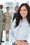 Young businesswoman standing upright with her hands crossed on h